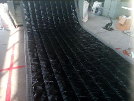 大棚保温被是目前较好的保温材料之一
